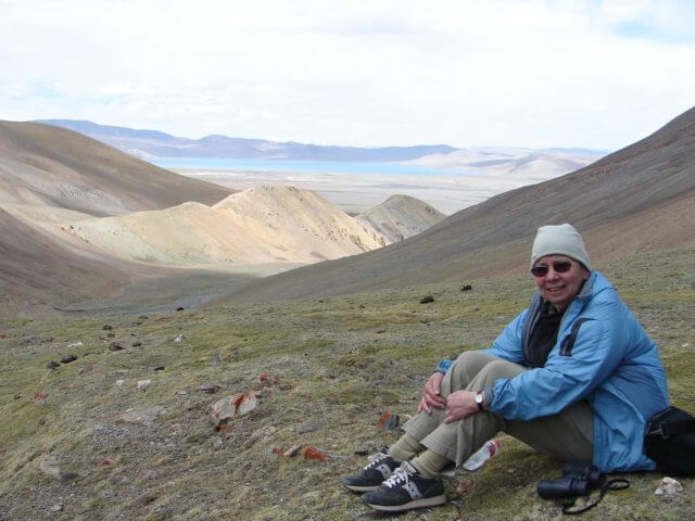 Jacqueline sitting down resting in the high plains of Tibet