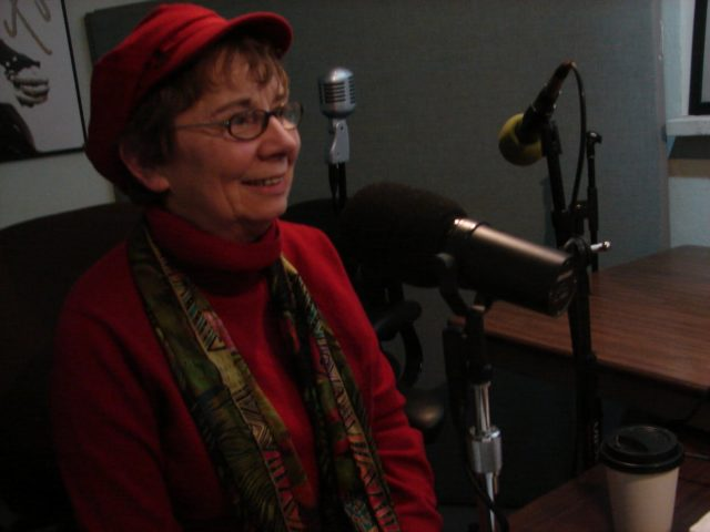 Jacqueline Briggs Martin sitting in front of a microphone setup.