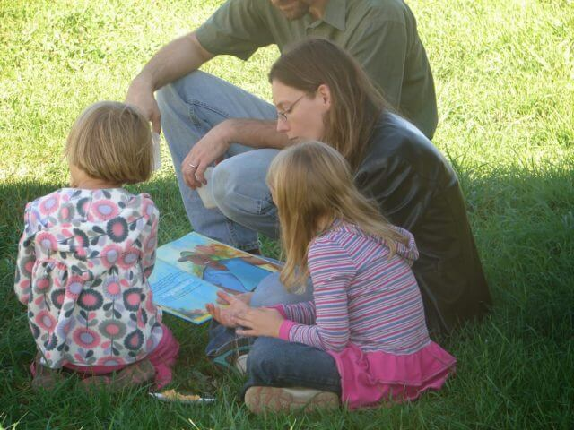 A family reading Farmer Will Allen and the Growing Table