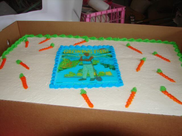 Cake with Farmer Will Allen book cover on it.