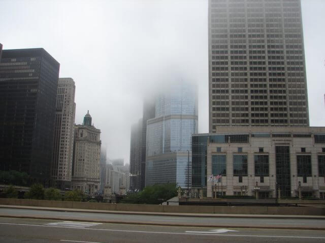 A cityscape encased in low clouds.