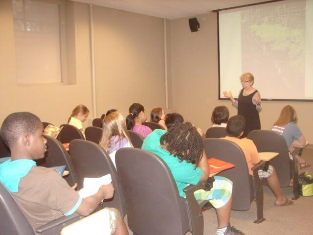 Jacqueline presenting to a room full of children