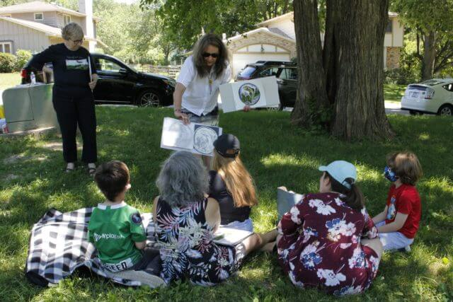 Authors and kids outside reading